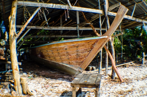 Building a boat on the beach.