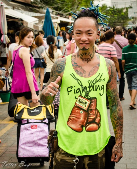 He definitely didn't need me to make up a character. People broke their necks off staring (like the girl in the background) so I went up and started a conversation. I showed him my tattoos, he showed me his and I asked him for a photo. No neck breaking required. ANd now I will forever remember him. Bangkok, 2013