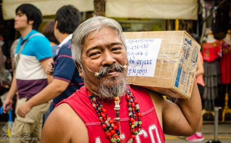 Non English speaker. I gestured that I wanted to photograph his mustache. He stood still for a few seconds and then continued packing boxes. Bangkok, November 2013