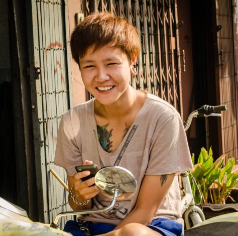 Bangkok has loads of tattooed people. She asked me if she could see mine, so I said yes. In return she gave me a beautiful smile. Bangkok, October 2013